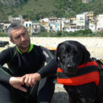 Black Labrador Retriever Doxy and Fabrizio during a rescue training